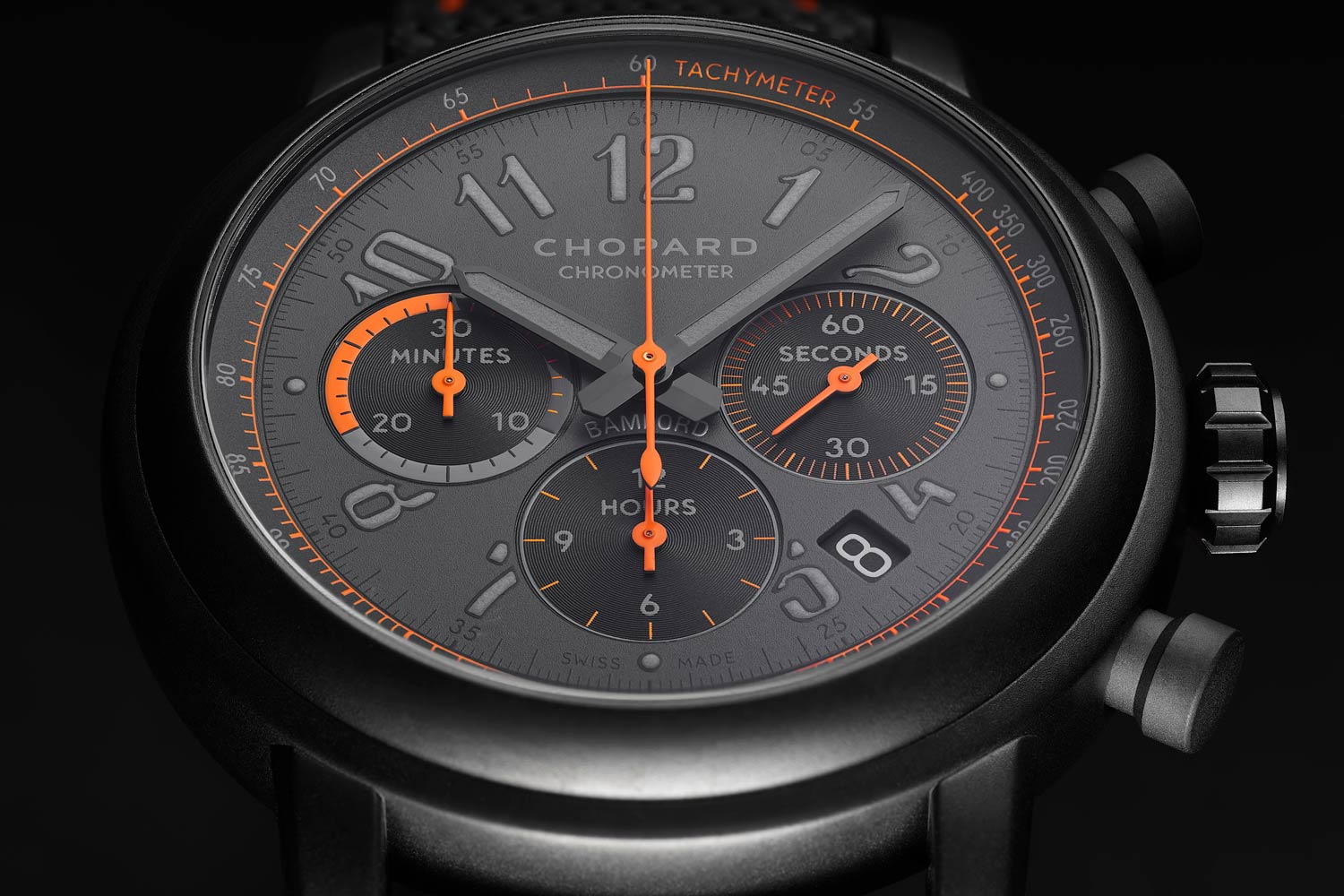 The dial in matte grey with 'flame orange' accents on the chronograph hands and sub dial