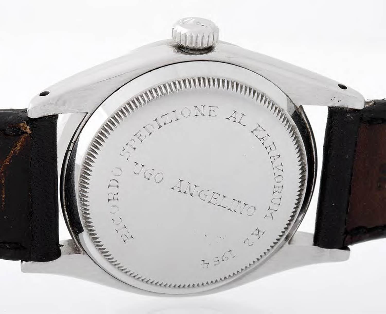 "The case back bears the inscription, ""RICORDO SPEDIZIONE AL KARAKORUM K2 194 UGO ANGELINO"""