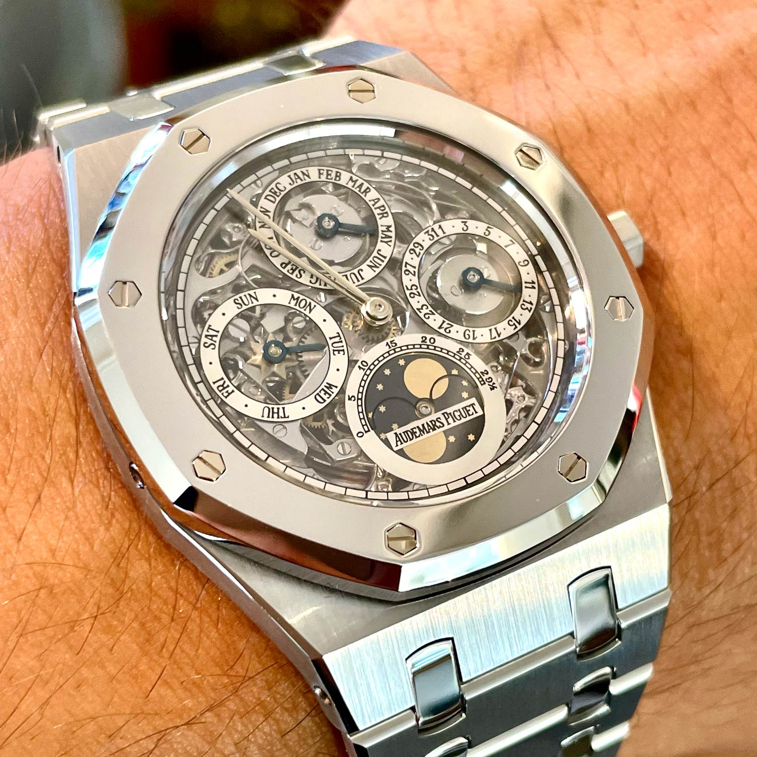 Lot 205 Audemars Piguet: Only 25 Pieces Made, Extremely Rare and Very Attractive Early Royal Oak Quantieme Perpetuel Automatic Wristwatch in Steel and Platinum, Reference 25636sp, With Skeletonized Dial, Box and Extract from The Archives
